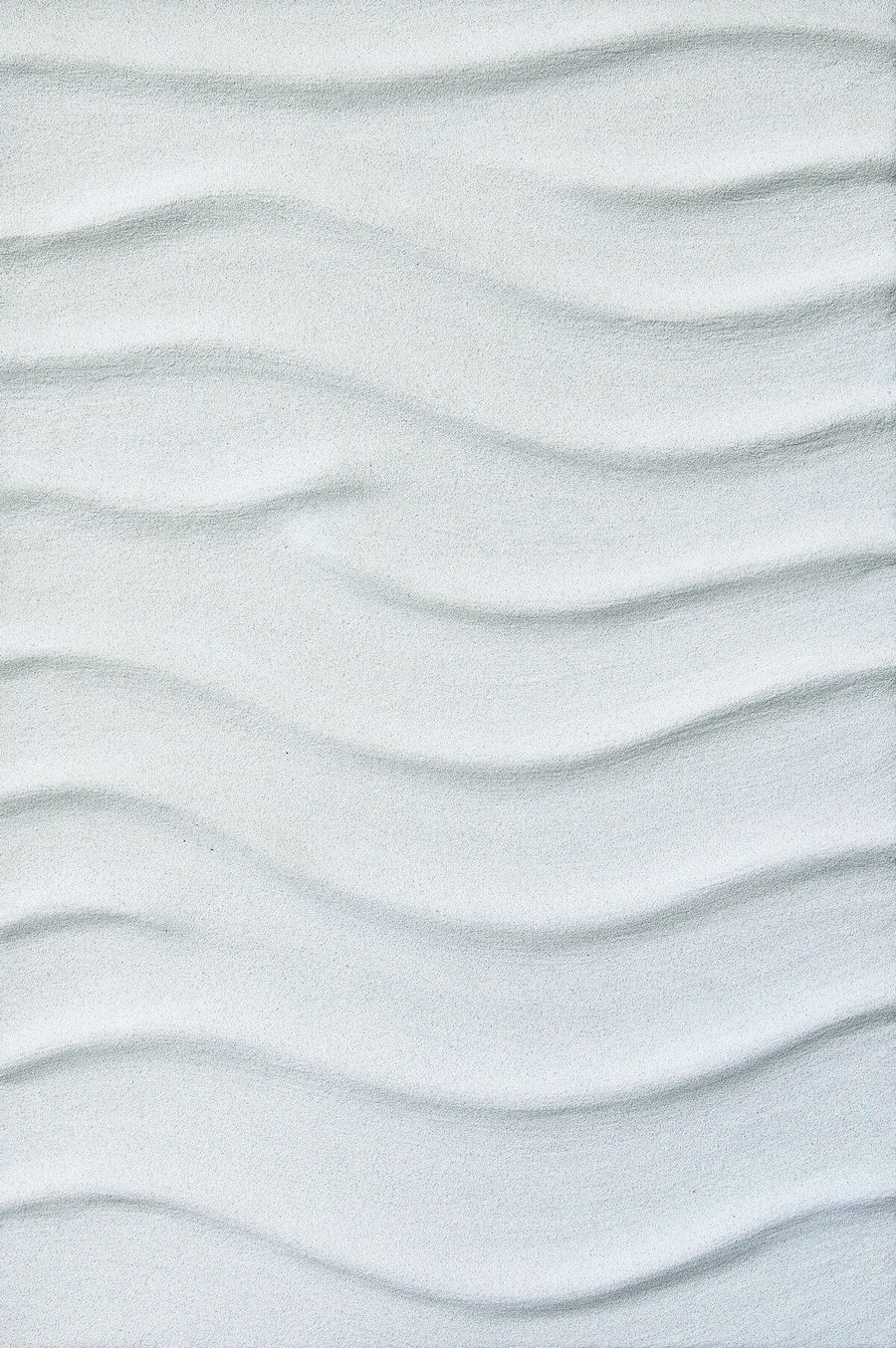 Plaster-and-sand-on-wood-panel very light grey/white in colour with smooth 3d waved lines across the panel